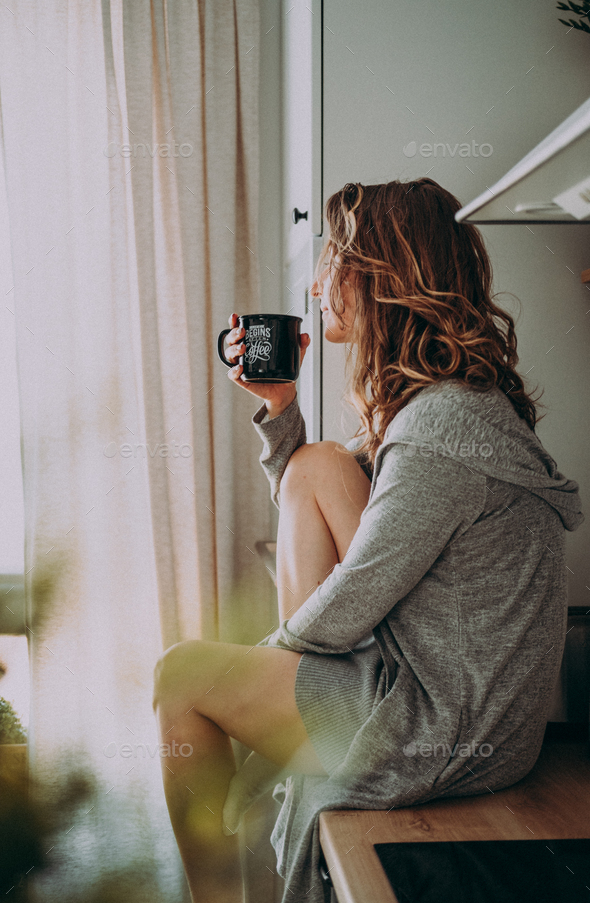 Young pretty woman drinks coffee - Stock Photo - Images