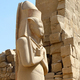 Statue of pharaoh Ramses II situated at Karnak Temple, Luxsor, Egypt - PhotoDune Item for Sale