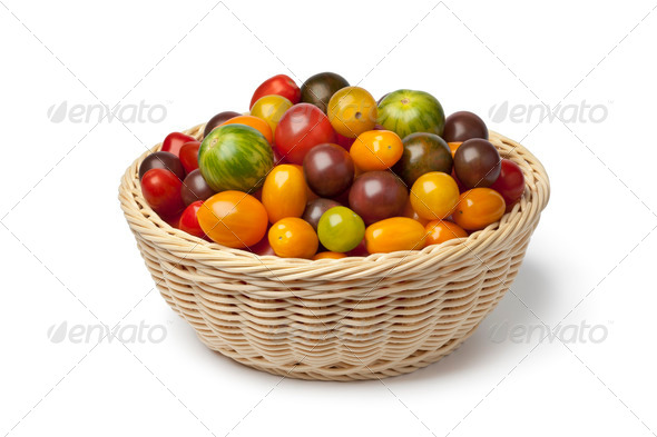 Basket with different color organic tomatoes - Stock Photo - Images
