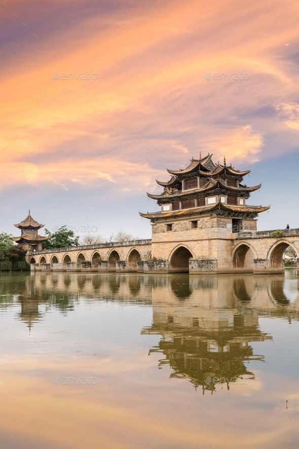 yunnan double dragon bridge at dusk - Stock Photo - Images