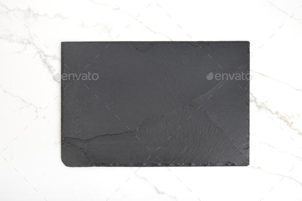 Empty Black slate Tray Plate on white marble background - Stock Photo - Images