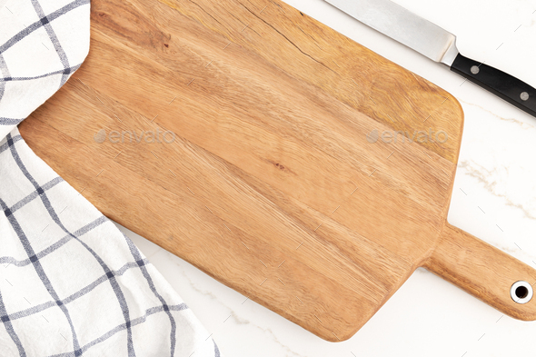 Empty cutting board on white marble background - Stock Photo - Images