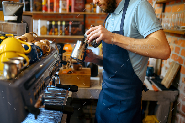 Male barista in apron prepares aroma coffee - Stock Photo - Images