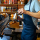 Male barista in apron prepares aroma coffee - PhotoDune Item for Sale