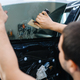 Worker installs wetted car tinting, tuning service - PhotoDune Item for Sale