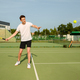 Male tennis player with racket hits the ball - PhotoDune Item for Sale