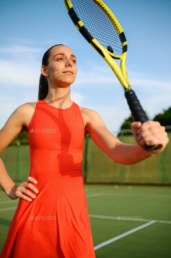 Female tennis player with racket on outdoor court - Stock Photo - Images
