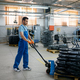 Worker carries bicycle wheels on a cart, factory - PhotoDune Item for Sale