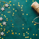 The New Year or Christmas festive flat lay with golden stars over a dark green background - PhotoDune Item for Sale