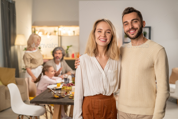 Happy young affectionate couple in casualwear looking at you with toothy smiles - Stock Photo - Images