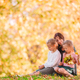 Little girl with mom outdoors in park at autumn day - PhotoDune Item for Sale