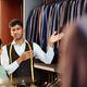 Shop assistant showing suit jackets - PhotoDune Item for Sale