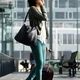 Happy travel woman walking at station with suitcase and talking on cellphone - PhotoDune Item for Sale