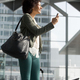 happy african American travel woman at station with mobile phone and luggage - PhotoDune Item for Sale