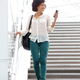 woman in 30s walking downstairs with mobile phone - PhotoDune Item for Sale