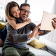 Young couple watching media content online in a tablet at home - PhotoDune Item for Sale
