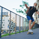Portrait of mature man riding skateboard outdoors in city, going back to work - PhotoDune Item for Sale