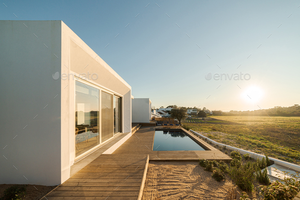 Modern villa with pool and deck - Stock Photo - Images