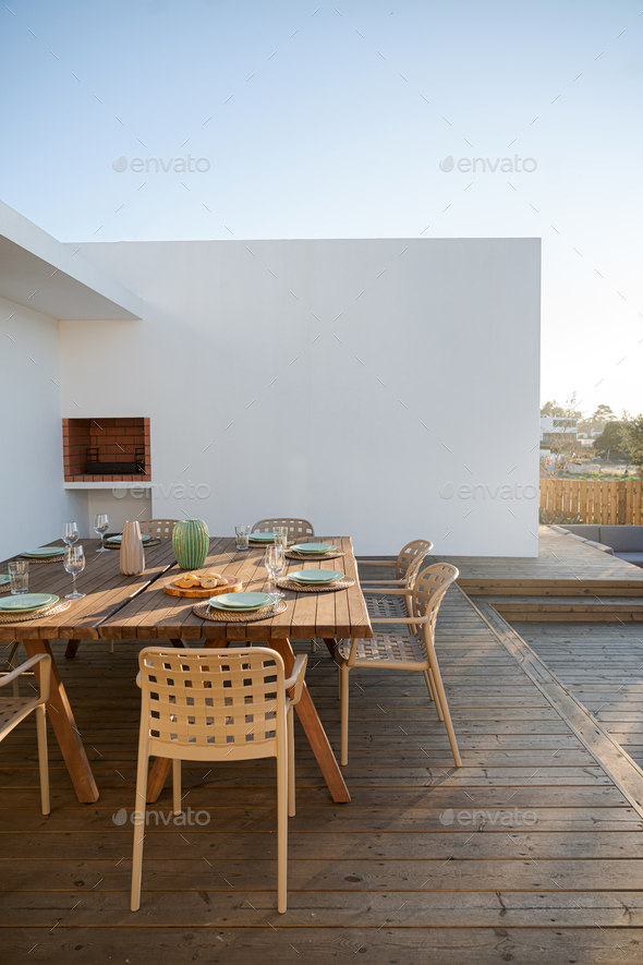 Dinner table setting in modern villa terrace - Stock Photo - Images