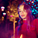 Cinematic portrait of handsome young woman in neon lighted room, stylish musician - PhotoDune Item for Sale