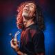Middle aged hispanic male smoking from bong on a dark background illuminated blue light - PhotoDune Item for Sale