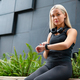 Female Runner Checks Workout Performance On Smart Watch - PhotoDune Item for Sale