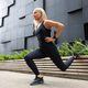 Close-up of Fit Woman Performing Lunge Workout Outdoor in the City - PhotoDune Item for Sale
