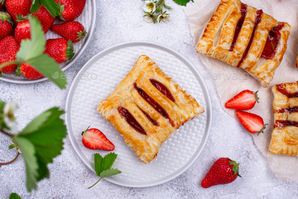 Sweet puff pastry cakes with strawberry - Stock Photo - Images