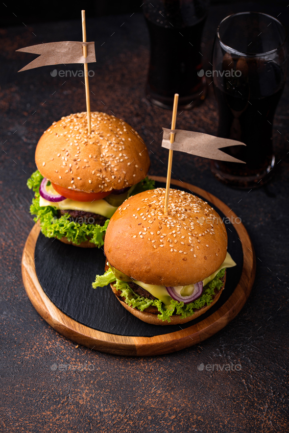 Burger and cheeseburger with tomato - Stock Photo - Images