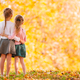 Little adorable girls outdoors at warm sunny autumn day - PhotoDune Item for Sale