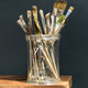 Glass jar filled with assorted artist paintbrushes - PhotoDune Item for Sale
