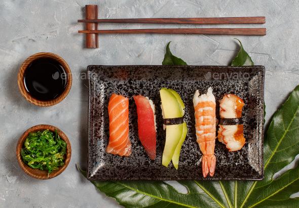 Sushi Set nigiri and sushi rolls on rectangular plate - Stock Photo - Images