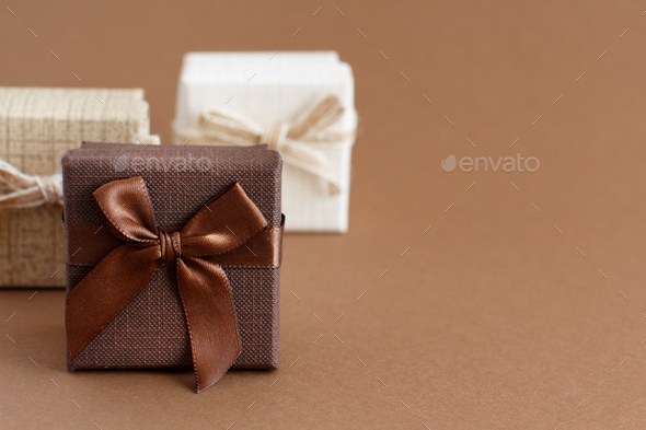Brown tones gift boxes on a brown background - Stock Photo - Images