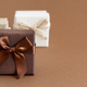 Brown tones gift boxes on a brown background - PhotoDune Item for Sale