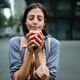 Happy young woman drinking take away coffee and walking with bags after shopping in city - PhotoDune Item for Sale