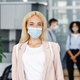 Modern manager returns to work after quarantine. Focus on attractive blonde woman in protective mask - PhotoDune Item for Sale