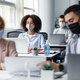 Guy and woman in protective masks are looking at paper, close up, blurred, focus on african american - PhotoDune Item for Sale