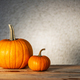 Two pumpkins on wooden table - PhotoDune Item for Sale
