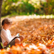 Adorable little girl at beautiful autumn day outdoors - PhotoDune Item for Sale
