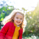 Adorable little girl walking in park on a fall day. - PhotoDune Item for Sale