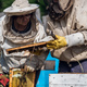 Elderly beekeepers are inspecting honeycombs. Local family apiary business - PhotoDune Item for Sale