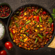 Chili con carne in skillet on dark stone table - PhotoDune Item for Sale