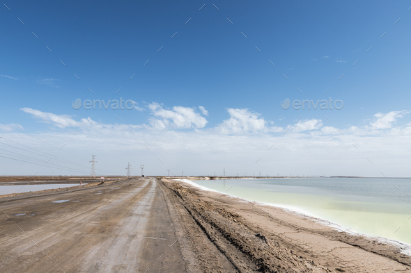 simple dirt road on salt lake - Stock Photo - Images