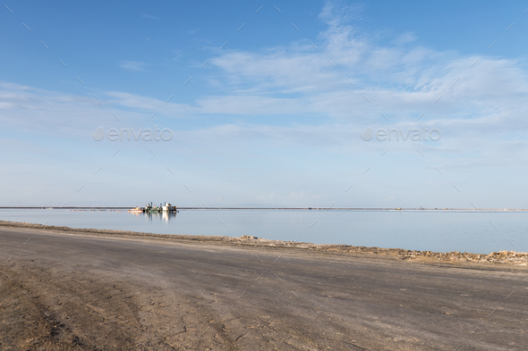simple road and salt lake industrial landscape - Stock Photo - Images