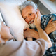 Happy senior couple embracing, sleeping together in bedroom - PhotoDune Item for Sale