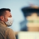 Man wearing face mask at airport - PhotoDune Item for Sale