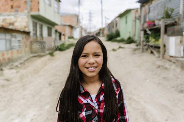 Portrait of beautiful girl in shanty town. - Stock Photo - Images