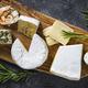 Cheese platter on dark stone table - PhotoDune Item for Sale