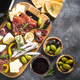 Antipasto board with sliced meat, ham, salami, cheese, olives an - PhotoDune Item for Sale