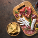 Antipasto - sliced meat, ham, salami, olives and wine top view - PhotoDune Item for Sale